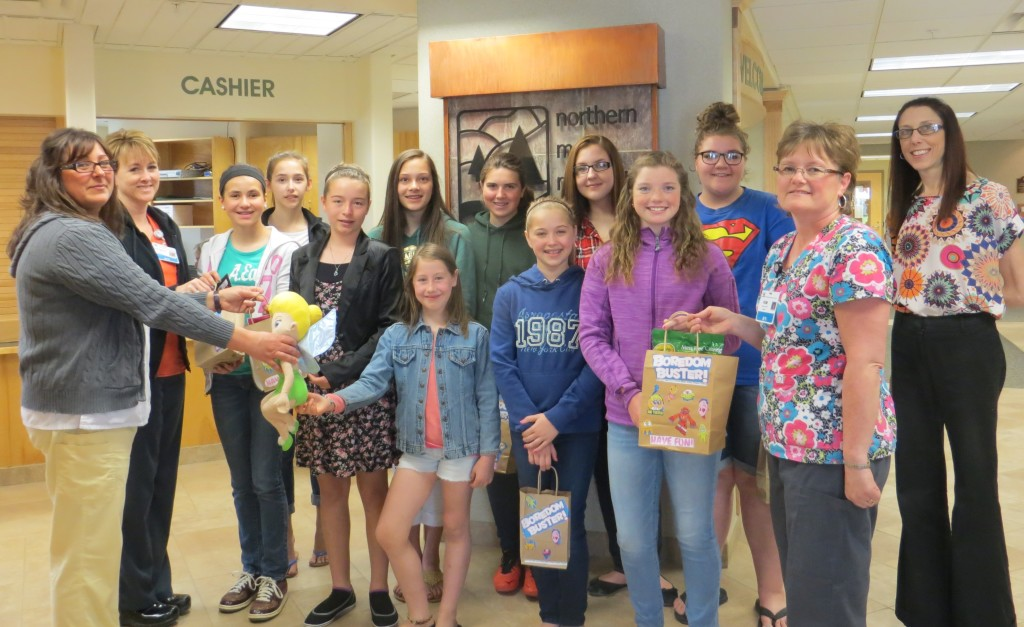 VRMS-Boredom-buster-bag-donation-05-21-15-Group-1024x627